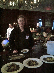 A grainy picture of me with my team's entree offering, which didn't look fantastic even in better lighting!