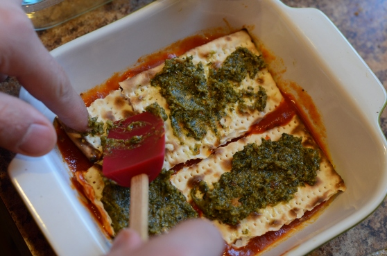 It is easier if you spread the pesto on the matzo before setting it in the pan, but this works too.