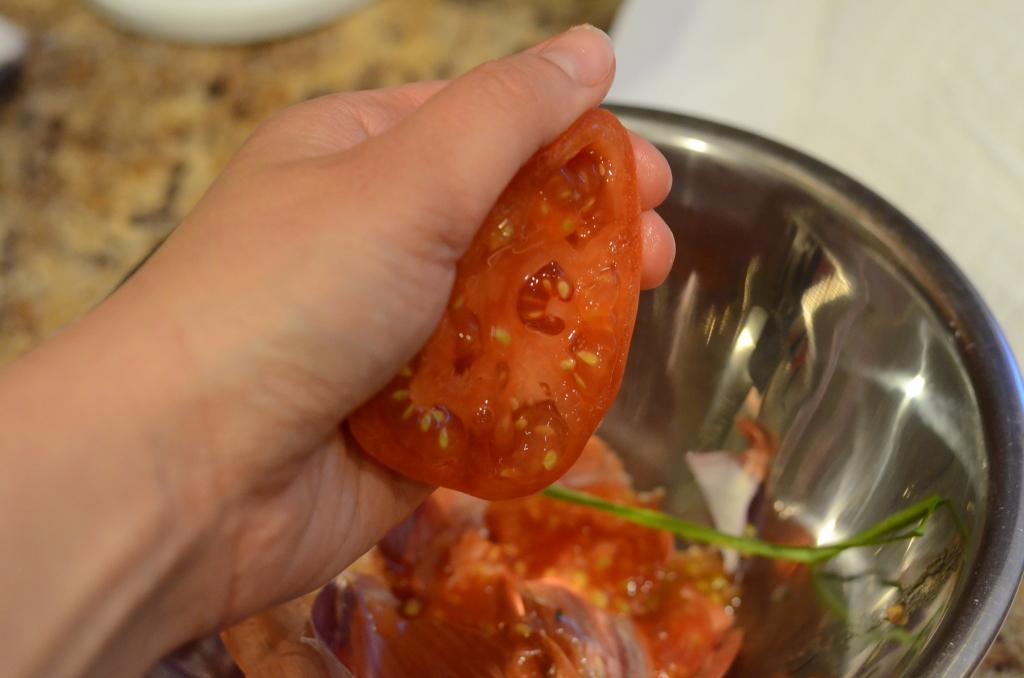 Seeding the tomato.